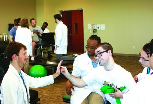 Faculty introduce volunteer participants to help OT and PT students put what they've learned into practice with hands-on experience before they leave for fieldwork or internships.