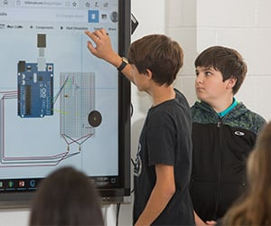 MOT and middles school students work together with emerging technologies to engineer innovative solutions to real world patient problems
