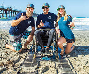 Through innovation in their Assistive Technologies class at USAHS, two MOT graduates created Beach Trax to support adaptive surfing.