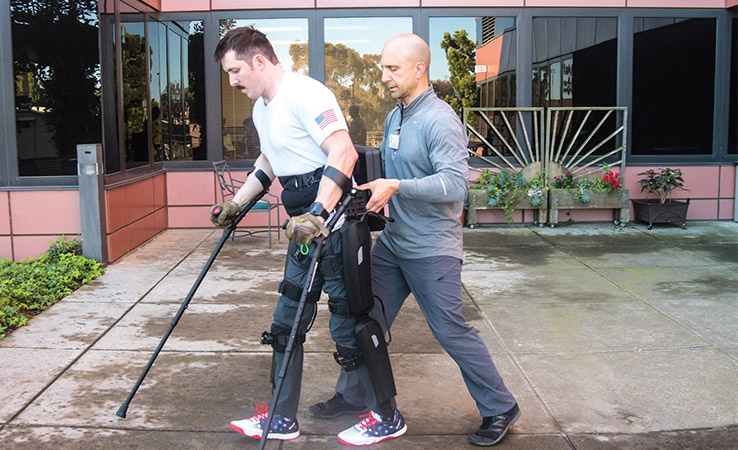 DPT graduate uses robotic walking device to provide physical therapy to veterans with spinal cord injury.