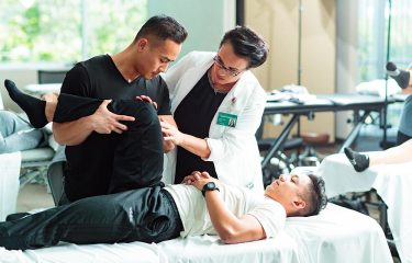 physical therapist helping a patient