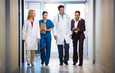 nurses walking down a hall
