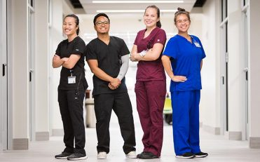 nurses standing in a hall posing for picture