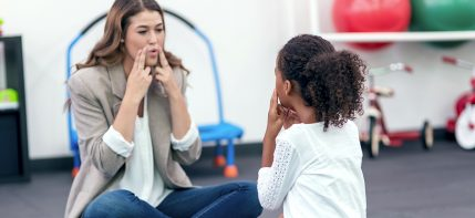 speech therapist working with a child