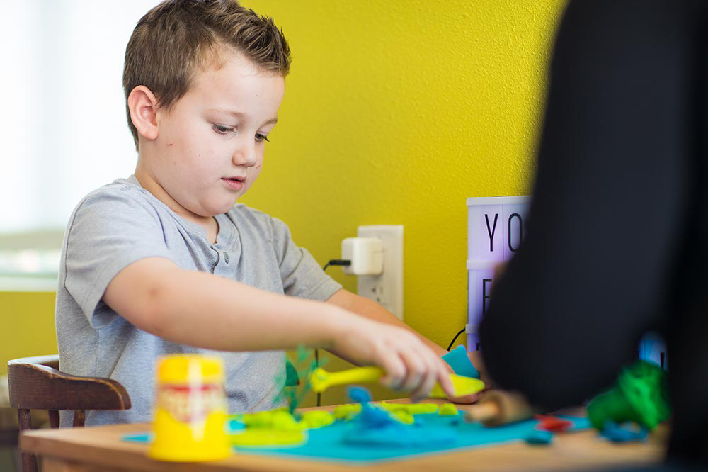 little boy engaging in occupational therapy activities