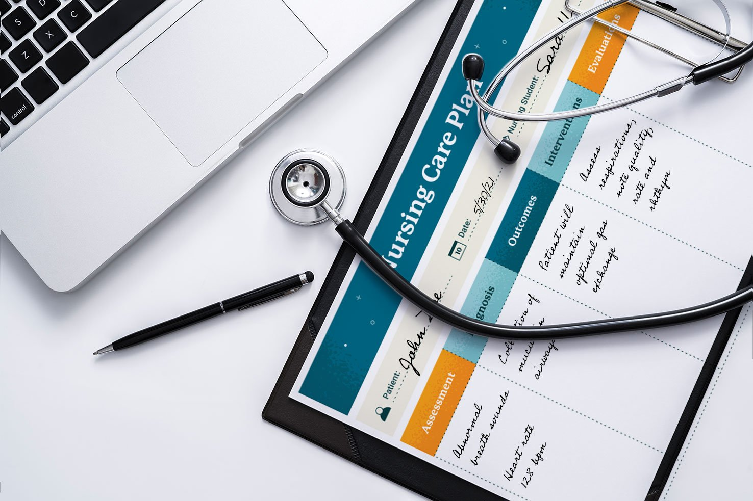 Sample nursing care plan sheet on desk with laptop and stethoscope