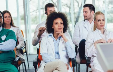 healthcare leaders listening to a presentation