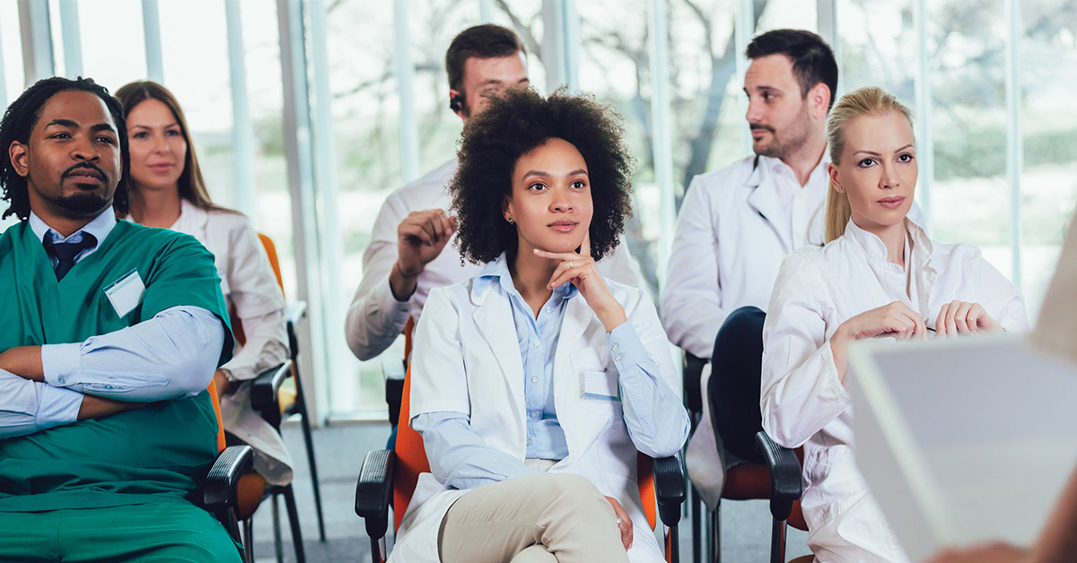 healthcare professionals listening to a presentation
